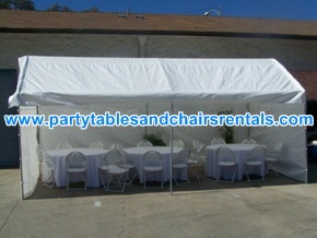 White party tent with walls, round folding tables and chairs with covers for rent